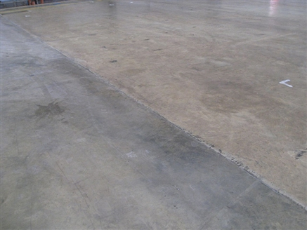 Cleaning Concrete Floor In Warehouse