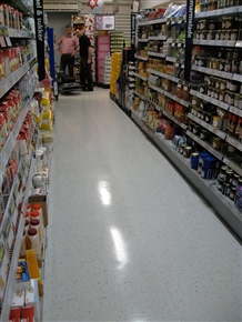 Look closely and you will see the result of UHS Burnishing. The whole aisle has had a polish treatment, the left hand side has been burnished whereas the right hand side hasn't.